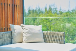 sofa with pillows in sunlight ,outdoors