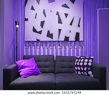 Sofa with pillows on a purple background.Interior design.