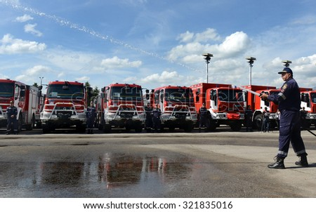 Sofia, Bulgaria - June 9, 2015: New fire trucks are presented to their firefighters in a field next to the main Fire department administrative building in Sofia. #321835016