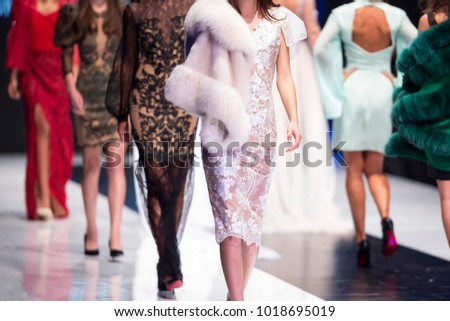 Sofia, Bulgaria - 28 September 2017: Female models walk the runway in different dresses during a Fashion Show. Fashion catwalk event showing new collection of clothes. In a row. #1018695019