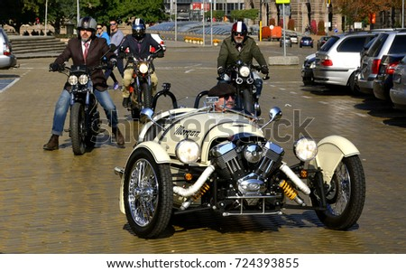 Sofia, Bulgaria - SEPTEMBER 24, 2017: Male rider on motorcycle is driving his motorbike and is wearing helmet and leather gloves on the Sofia Riders Gentleman's Ride day, for cancer fundraiser