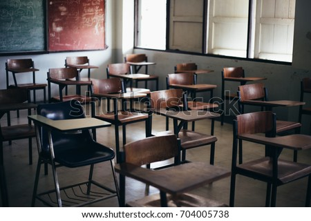 soft and blur focus.row lecture chairs in classroom in poor school