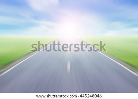 Soft and blur high speed road with blue skies background. #445248046