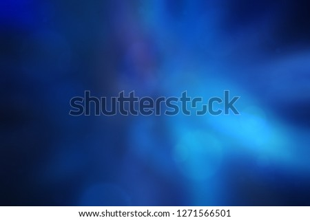 Soft and blurred dark blue abstract gradient background with bokeh.