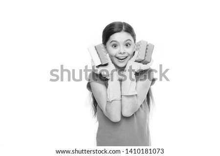 Soft and colorful. Small housekeeper holding dish sponges in rubber gloves. Adorable kitchen maid. Little housemaid ready for household help. Household duties. Cleaning and washing up. #1410181073