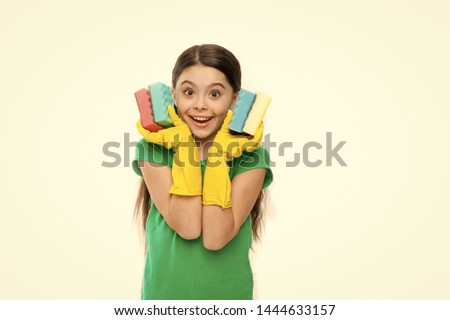 Soft and colorful. Small housekeeper holding dish sponges in rubber gloves. Adorable kitchen maid. Little housemaid ready for household help. Household duties. Cleaning and washing up. #1444633157