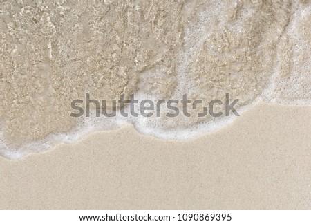 Soft beautiful ocean wave on beach background  #1090869395