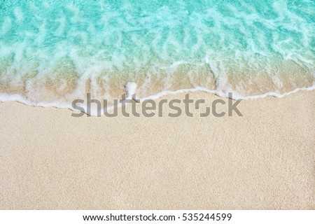 Soft beautiful ocean wave on sandy beach. Background. #535244599