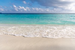 Soft beautiful ocean wave on the white sandy beach. Background