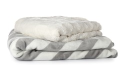 Soft blankets on white background