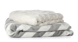 Soft blankets on white background