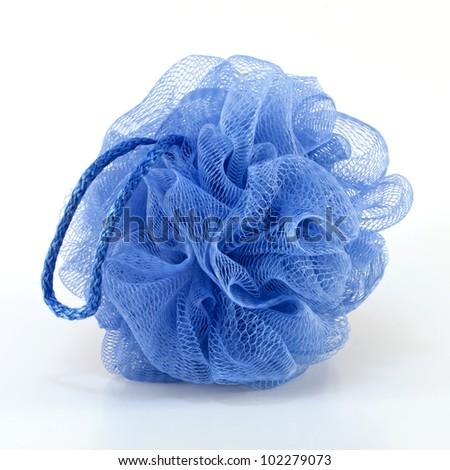 Soft blue bath puff or sponge with rode handle isolated on white background.