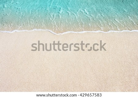 Soft Blue Ocean Wave On Sandy Beach. Background.