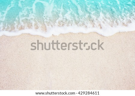Soft Blue Ocean Wave On Sandy Beach. Background. Selective focus. #429284611
