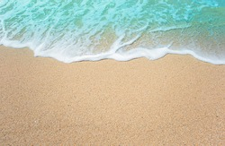 Soft blue ocean wave on the beach and soft wave background.