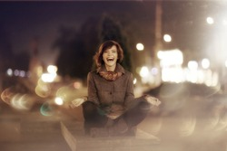 soft blurred portrait happy girl in the autumn night city