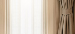 soft brown curtain with morning light from window bedroom background banner header size image