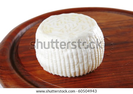 soft cheese on plate isolated over white