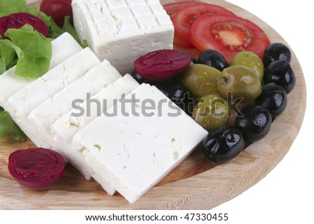 soft cheese served with vegetables on plate