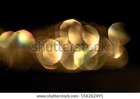 Stock Photo Soft colorful bokeh background. Luminous garlands of electric lights. Copy space to add text. Saturated colors. Blurry abstraction. Gentle tone. Dark night. Festive party in city. Defocus effect.