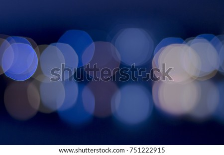 Soft colorful bokeh background. Luminous garlands of electric lights. Copy space to add text. Saturated colors. Blurry abstraction. Gentle tone. Dark night. Festive party in city. Defocus effect. #751222915