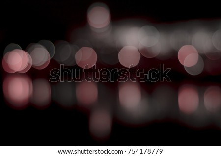 Soft colorful bokeh background. Luminous garlands of electric lights. Copy space to add text. Saturated colors. Blurry abstraction. Gentle tone. Dark night. Festive party in city. Defocus effect. #754178779