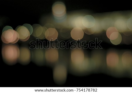 Soft colorful bokeh background. Luminous garlands of electric lights. Copy space to add text. Saturated colors. Blurry abstraction. Gentle tone. Dark night. Festive party in city. Defocus effect. #754178782