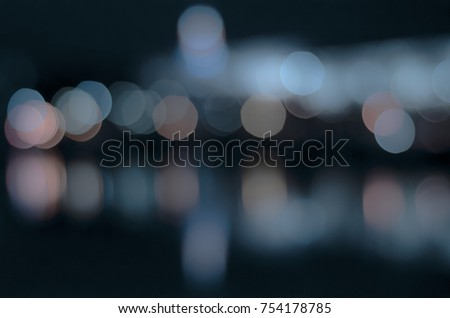 Soft colorful bokeh background. Luminous garlands of electric lights. Copy space to add text. Saturated colors. Blurry abstraction. Gentle tone. Dark night. Festive party in city. Defocus effect. #754178785