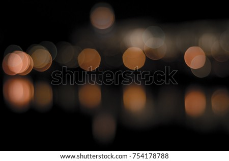 Soft colorful bokeh background. Luminous garlands of electric lights. Copy space to add text. Saturated colors. Blurry abstraction. Gentle tone. Dark night. Festive party in city. Defocus effect. #754178788