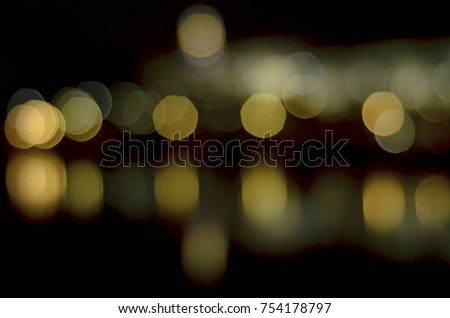 Soft colorful bokeh background. Luminous garlands of electric lights. Copy space to add text. Saturated colors. Blurry abstraction. Gentle tone. Dark night. Festive party in city. Defocus effect. #754178797