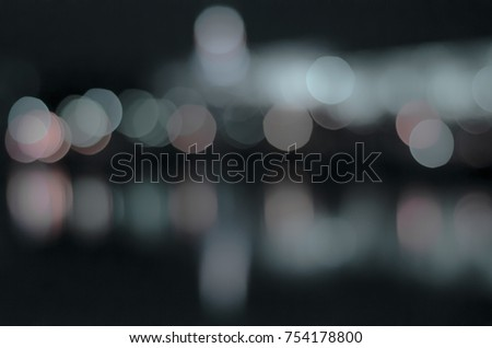 Soft colorful bokeh background. Luminous garlands of electric lights. Copy space to add text. Saturated colors. Blurry abstraction. Gentle tone. Dark night. Festive party in city. Defocus effect. #754178800