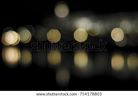 Soft colorful bokeh background. Luminous garlands of electric lights. Copy space to add text. Saturated colors. Blurry abstraction. Gentle tone. Dark night. Festive party in city. Defocus effect. #754178803