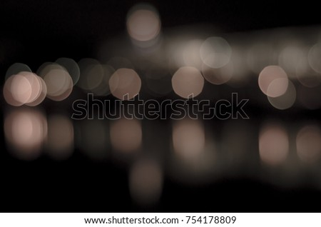 Soft colorful bokeh background. Luminous garlands of electric lights. Copy space to add text. Saturated colors. Blurry abstraction. Gentle tone. Dark night. Festive party in city. Defocus effect. #754178809