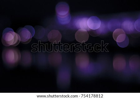 Soft colorful bokeh background. Luminous garlands of electric lights. Copy space to add text. Saturated colors. Blurry abstraction. Gentle tone. Dark night. Festive party in city. Defocus effect. #754178812
