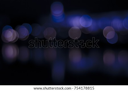 Soft colorful bokeh background. Luminous garlands of electric lights. Copy space to add text. Saturated colors. Blurry abstraction. Gentle tone. Dark night. Festive party in city. Defocus effect. #754178815