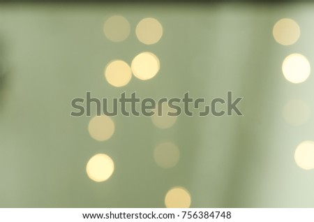 Soft colorful bokeh background. Luminous garlands of electric lights. Copy space to add text. Saturated colors. Blurry abstraction. Gentle tone. Dark night. Festive party in city. Defocus effect. #756384748