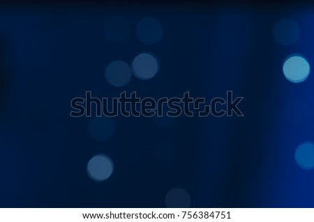 Soft colorful bokeh background. Luminous garlands of electric lights. Copy space to add text. Saturated colors. Blurry abstraction. Gentle tone. Dark night. Festive party in city. Defocus effect. #756384751