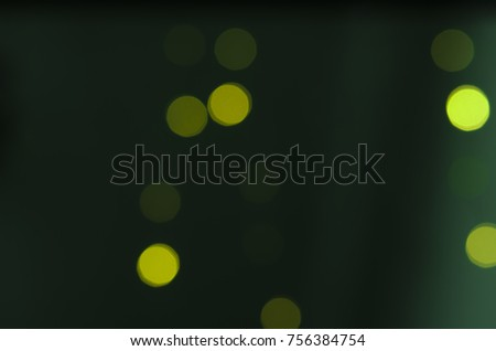 Soft colorful bokeh background. Luminous garlands of electric lights. Copy space to add text. Saturated colors. Blurry abstraction. Gentle tone. Dark night. Festive party in city. Defocus effect. #756384754