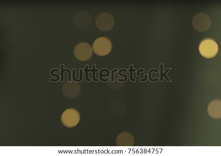Soft colorful bokeh background. Luminous garlands of electric lights. Copy space to add text. Saturated colors. Blurry abstraction. Gentle tone. Dark night. Festive party in city. Defocus effect. #756384757