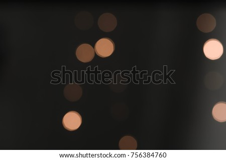 Soft colorful bokeh background. Luminous garlands of electric lights. Copy space to add text. Saturated colors. Blurry abstraction. Gentle tone. Dark night. Festive party in city. Defocus effect. #756384760