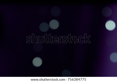 Soft colorful bokeh background. Luminous garlands of electric lights. Copy space to add text. Saturated colors. Blurry abstraction. Gentle tone. Dark night. Festive party in city. Defocus effect. #756384775