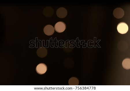 Soft colorful bokeh background. Luminous garlands of electric lights. Copy space to add text. Saturated colors. Blurry abstraction. Gentle tone. Dark night. Festive party in city. Defocus effect. #756384778