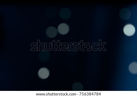 Soft colorful bokeh background. Luminous garlands of electric lights. Copy space to add text. Saturated colors. Blurry abstraction. Gentle tone. Dark night. Festive party in city. Defocus effect. #756384784