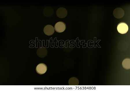 Soft colorful bokeh background. Luminous garlands of electric lights. Copy space to add text. Saturated colors. Blurry abstraction. Gentle tone. Dark night. Festive party in city. Defocus effect. #756384808