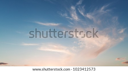 Soft colorful clouds in evening sky, natural background photo #1023412573