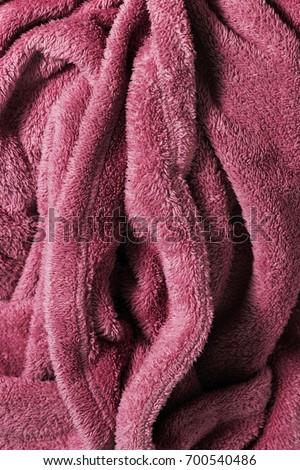 Soft fabric blanket shaped as a female genital organ