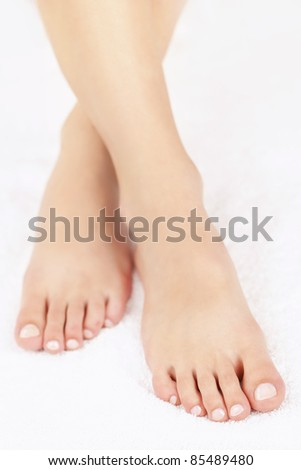 Soft female feet with pedicure close up