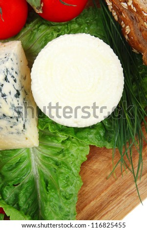 Soft Feta Cheese With Aged Delicatessen Cheeses On Cutting ...
