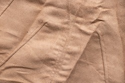 soft fleecy brown fabric as background close-up, fashion