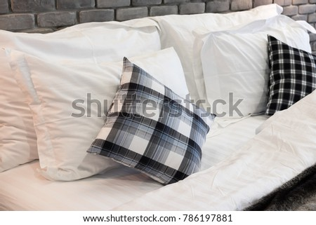 Soft fluffy white with design pillows on bed for sleeping comfort, for good morning to start the day #786197881